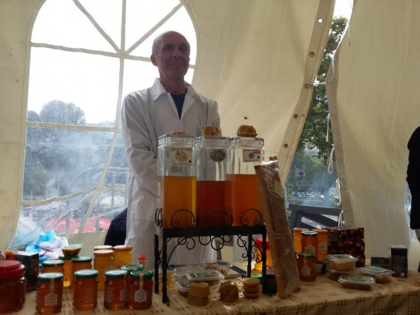 Demur Darsania shows honey produced in the CBDN apiary